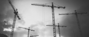 Construction-Cranes-in-Fog-Grey-Scale CASL Group
